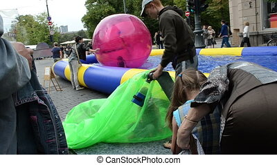 girl zorb ball inflate - VILNIUS, LITHUANIA - SEPTEMBER 1:...