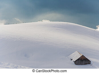Mountain hut in the French alps covered with snow.