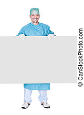 Doctor In Operation Gown Holding Blank Placard On White...