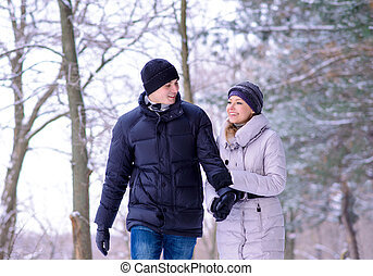 Young Beautiful Couple Smiling Outdoors in Snowy Winter