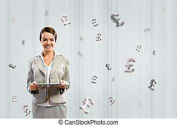business woman holding a tablet and smile - attractive...