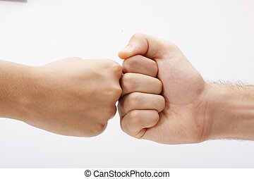 Two clenched fists opposite
