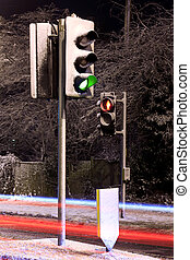 Traffic lights covered in snow