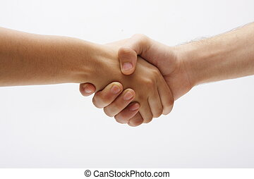 A hand shake - Horizontal front shot of two hands clasping...