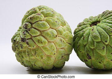 Fresh and green custard apples on a white surface Custard...