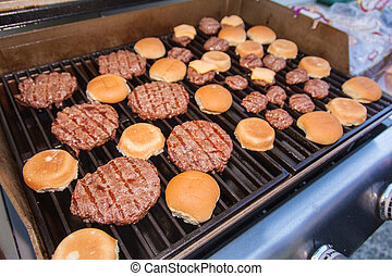 Garden grilling - Meat cooking on a charcoal grill in a...