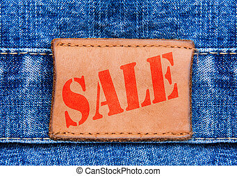 Closeup jeans leather label with text sale