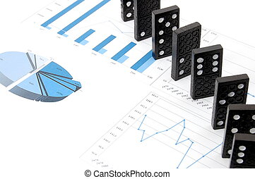 dominoes on chart - some domino stones on a blue business...