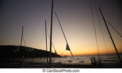Docked sailboats at sunset. Timelap - Sailboats on the beach...