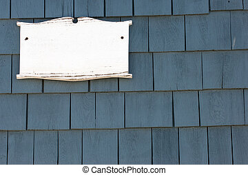 New England house - Blank white plaque on tiled wall of New...