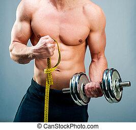man measuring bicepsc - muscular man measuring his biceps...