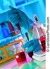 Scientist adjusts pH of assay buffer solution