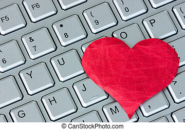 Internet dating concept - Red heart on the computer...