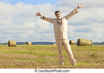 Carefree man standing in golden wheat