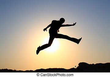 Jump For Joy Silhouette - silhouette of a happy young male...