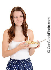 Teen girl holding bowl of cereal - isolated Teen girl...