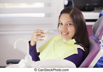 I love visiting the dentist - Happy teenage girl during a...