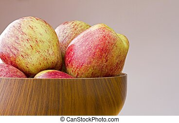 Wooden bowl of fresh ripe cameo apples