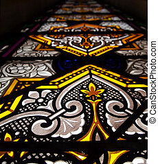Stained Glass - A tall stained glass window in a church,...
