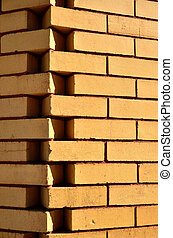 Dove tailed bricks - Tan bricks form a corner by dovetail...