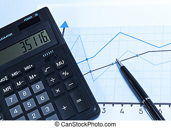 Financial charts and graphs on the table - Financial charts,...