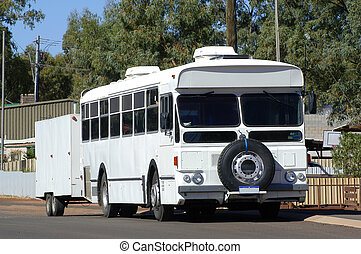 bus arranged in camp-site because