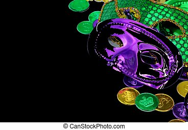 Mardi Gras masks - Green mardi gras masks and coins isolated...