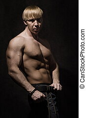 Muscular bodybuilder - hree quarter body portrait of...