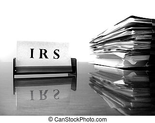 IRS Card with Tax Files - IRS Card on desck with tax files