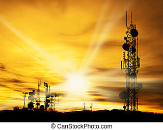 Radio Towers and Sunshine - Several radio towers with sunset...