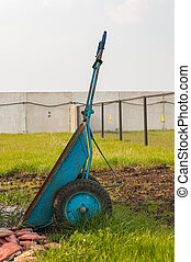 wheelbarrow on green grass