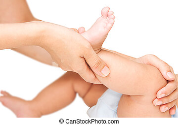 Mother hand massaging leg and foot muscle of her baby,touch...