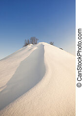 the snow-covered hill - the high hill covered with snow on...