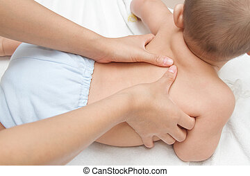 Mother hand massaging back muscle of her baby,touch of...