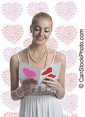blonde girl takes a valentine postcard