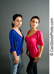 pair of latinas - a pair of latinas in urban fashion