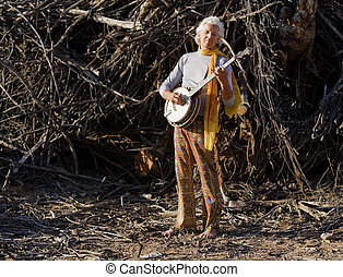 Barefoot Banjo Player - Barefoot banjo Player in Fraont of a...