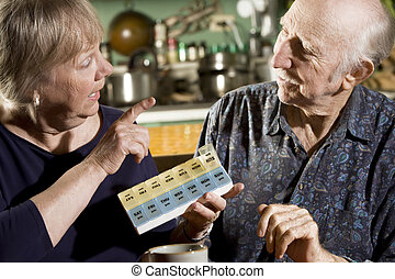 Portrait of Senior Couple with Pill Case - Portrait of...
