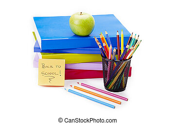 a green apple with back to school books - Shot of books by a...