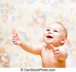 Laughing baby hands up - Laughing baby lools up and hands up