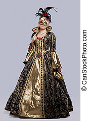 Young girl in carnival costume with mask - Full length...