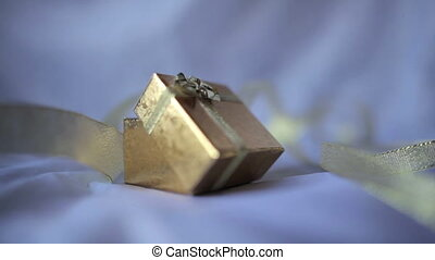 gift box with golden ribbons