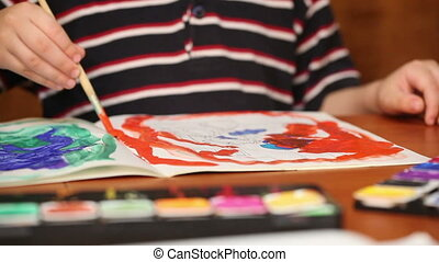 child draws paints 5