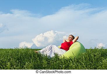 Relaxing in nature - enjoying the sun - Woman relaxing in...