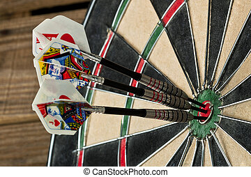 close up cropped image of the dart board with pins - A...