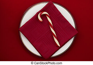 candy cane on red background - A top view image of sweet...