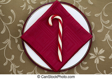 candy cane with red table napkin - Image of candy cane with...
