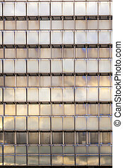 reflection of sky and clouds in a facade of a skyscraper