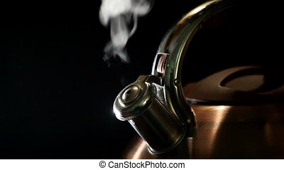boiling kettle on a black background 2 - boiling kettle on a...