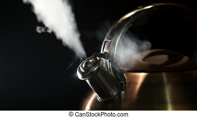 boiling kettle on a black background 3